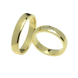 Lekko półokrągłe obrączki ślubne wykonane z żółtego złota z brylantami